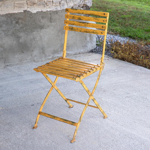 Distressed Yellow Iron Folding Chair